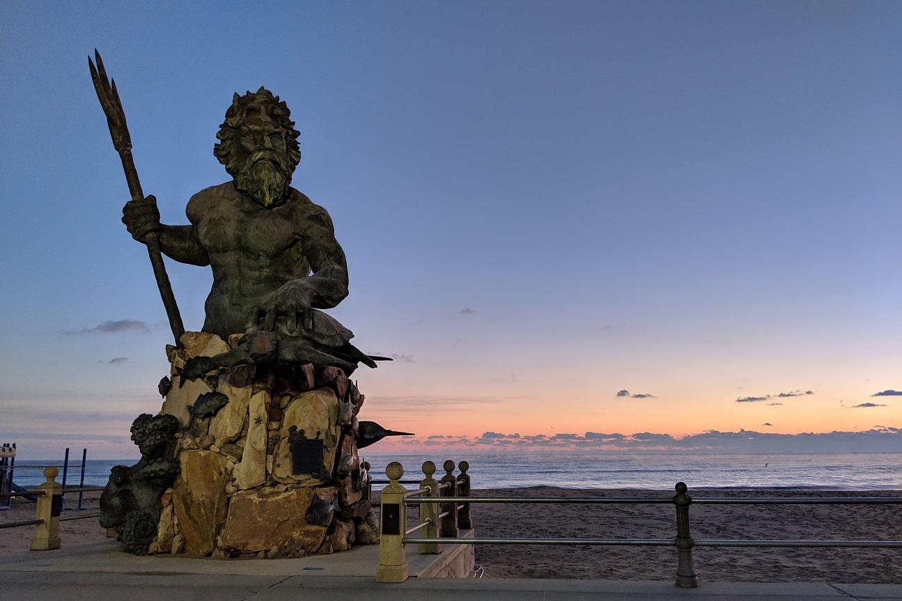 neptune statue sunrise on the boardwalk in Virginia Beach